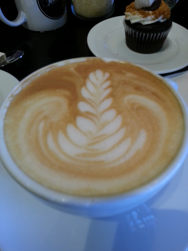 Coffee art and cupcake