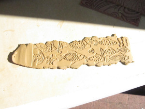 decorated clay strip